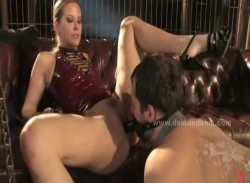 Blonde sexy powerfull mistress spanks her slave before using him in female domination
