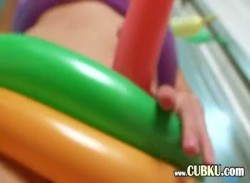 naked asian coed playing with toys